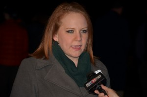 Stefanie Mundhenk, Baylor sexual assault survivor, speaks to media at Survivors' Stand prayer vigil.
